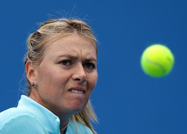 Maria Sharapova of Russia prepares to make a backhand return during a practice session ahead of the Australian Open tennis championship in Melbourne Australia, Sunday, Jan. 12, 2014. (AP Photo/Aaron Favila)