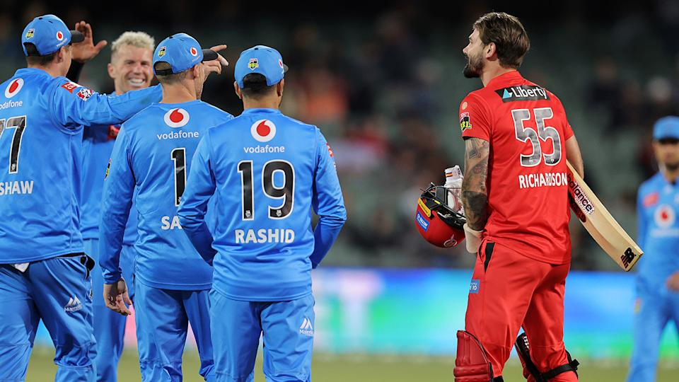 Kane Richardson has words with the Adelaide Strikers after losing his wicket. (Photo by Daniel Kalisz/Getty Images)