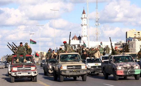 Members of the new Libyan military force under the ruling National Transitional Council parade along a main street in the Libyan capital Tripoli on February 14, 2012, to mark the one year anniversary of the start of the uprising which saw the death of former leader Moamer Khadfi.  AFP PHOTO/MAHMUD TURKIA (Photo credit should read MAHMUD TURKIA/AFP/Getty Images)