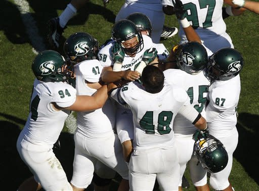 Sacramento State place kicker Edgar Castaneda, center, celebrates with teammates after making the winning field goal against Colorado in the fourth quarter of their NCAA college football game in Boulder, Colo., Saturday, Sept. 8, 2012. Sacramento State won 30-28. (AP Photo/David Zalubowski)