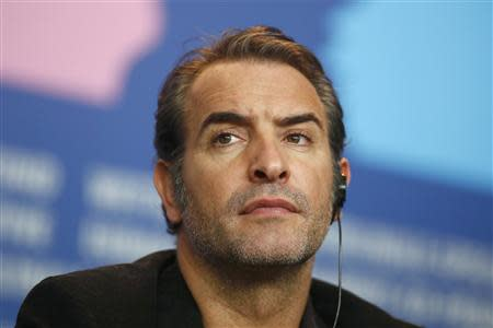 Cast member Jean Dujardin attends a news conference to promote the movie 'The Monuments Men' at the 64th Berlinale International Film Festival in Berlin February 8, 2014. REUTERS/Thomas Peter