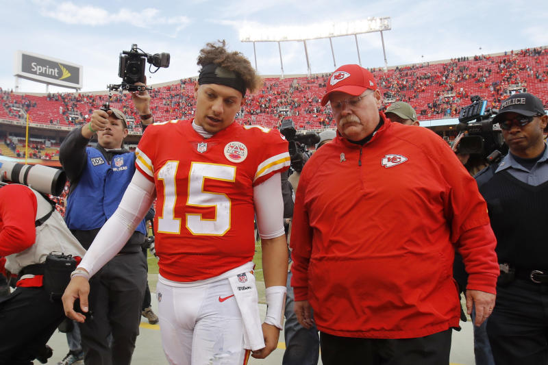 Kansas City Chiefs quarterback Patrick Mahomes (15) walks off the field with head coach Andy Reid. (AP)