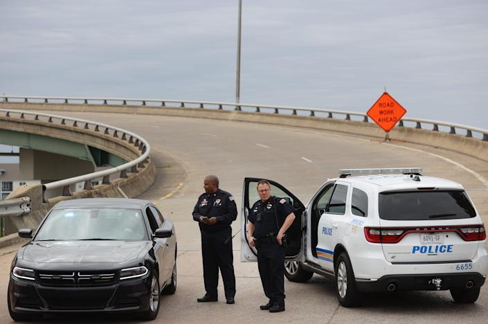 Memphis Police block the entrance to the Hernando de Soto bridge after a 'Structural crack' was found, closing all I-40 lanes over Mississippi River on Tuesday, May 11, 2021.