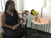 Dedra Spears Johnson, Heart to Hand Inc. executive director and co-founder, sits in her office in a Washington suburb looking at a picture of co-founder Sally Joseph, who died from cancer in 2009