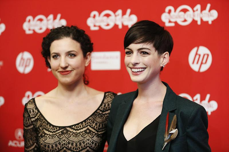 "FILE - In this Mon., Jan. 20, 2014 file photo, writer and director Kate Barker-Froyland, left, and cast member Anne Hathaway, pose together at the premiere of the film ""Song One"" during the 2014 Sundance Film Festival, in Park City, Utah. (Photo by Danny Moloshok/Invision/AP, File)"