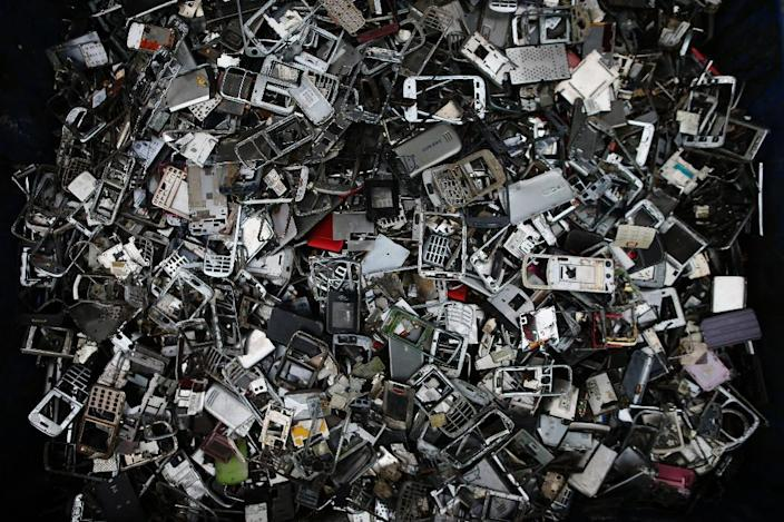 The world produces close to 50 million tonnes of e-waste every year as consumers and businesses throw out their old smartphones, computers and household appliances -- matrial worth an estimated $62.5 billion (55 billion euros) (AFP Photo/CHARLY TRIBALLEAU)