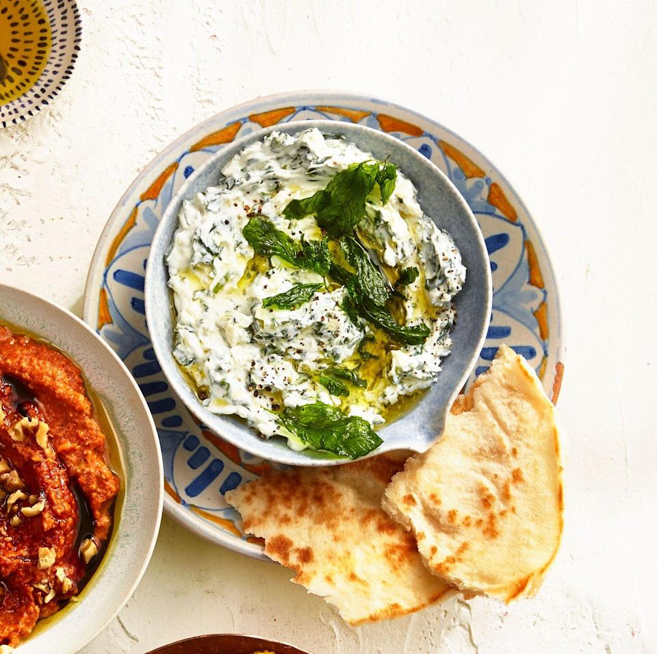 "<p>This Iranian-inspired dip combines plain yogurt with spinach and mint for a tangy, fresh option at the snack table. </p><p><em><a href=""https://www.goodhousekeeping.com/food-recipes/a34975164/spinach-yogurt-dip-recipe/"" rel=""nofollow noopener"" target=""_blank"" data-ylk=""slk:Get the recipe for Spinach and Yogurt Dip »"" class=""link rapid-noclick-resp"">Get the recipe for Spinach and Yogurt Dip »</a></em></p>"