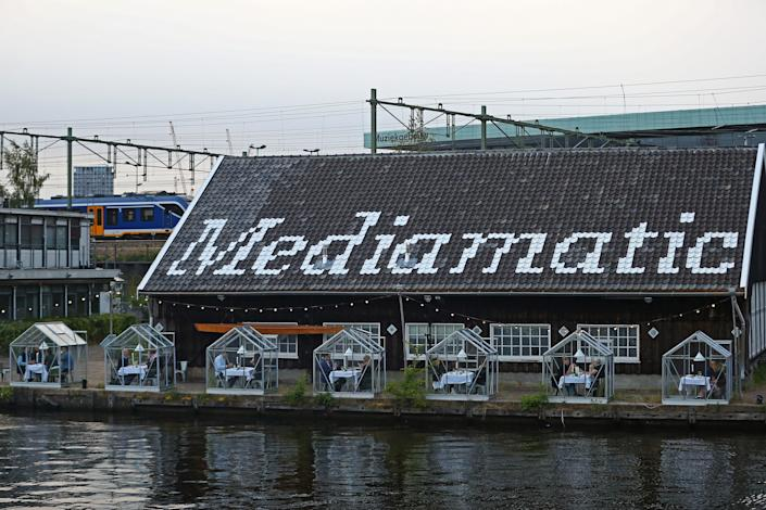 """<h1 class=""""title"""">Netherlands Businesses Reopen As Lockdown Further Eased</h1> <div class=""""caption""""> Patrons are seated outside of Amsterdam's Mediamatic restaurant. </div> <cite class=""""credit"""">Photo: Getty Images/Dean Mouhtaropoulos</cite>"""