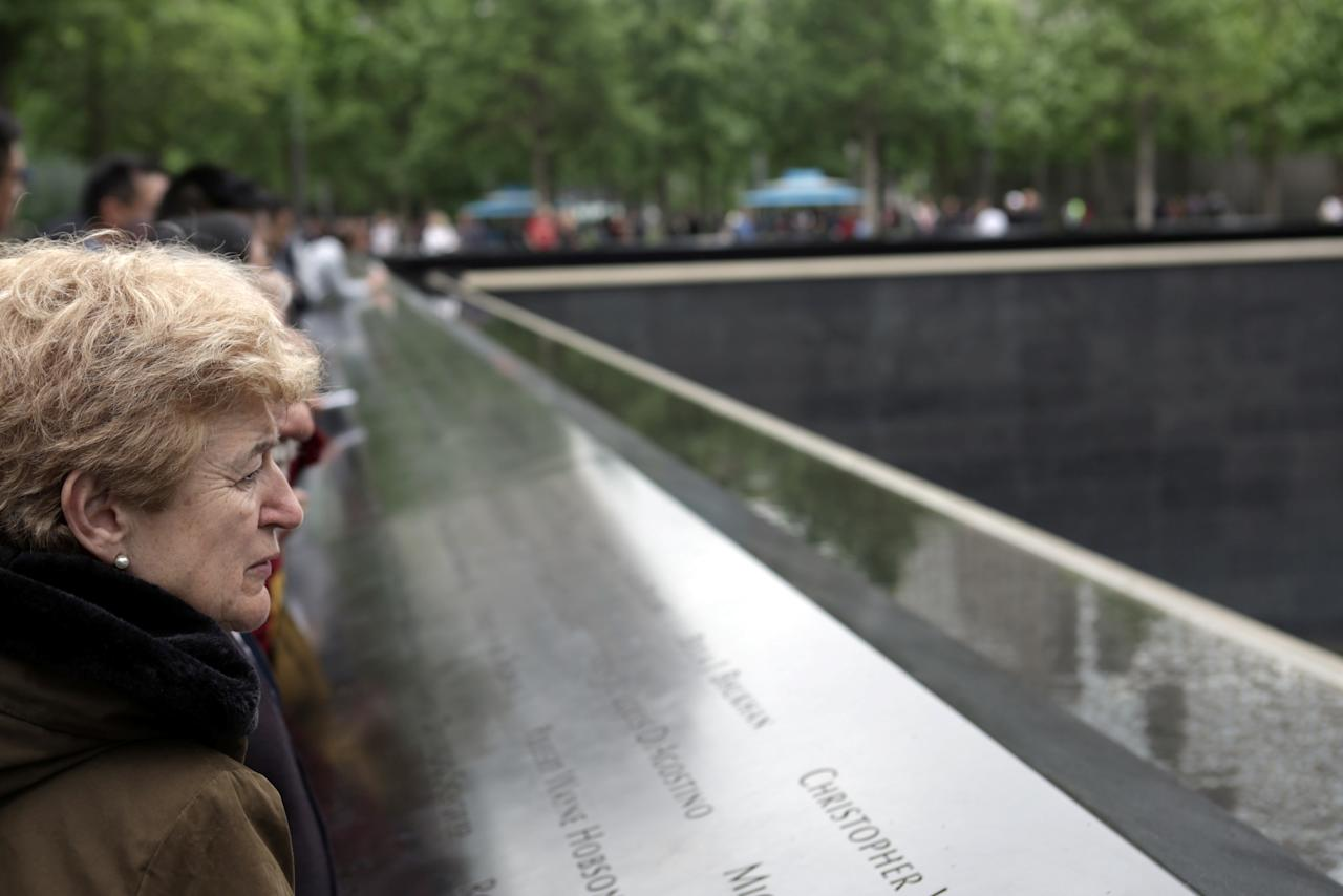 Tourists look at the National September 11 Memorial & Museum in New York City, U.S., May 20, 2017. REUTERS/Joe Penney