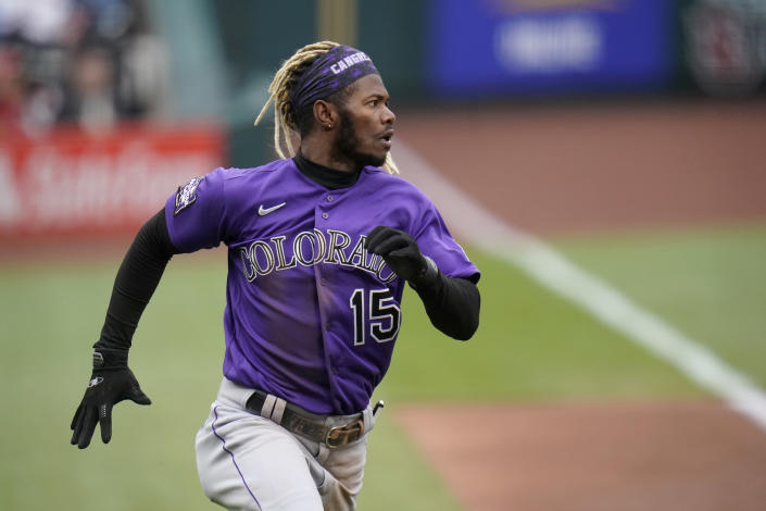 Colorado Rockies' Raimel Tapia runs in to score during the first inning of a baseball game against the St. Louis Cardinals Saturday, May 8, 2021, in St. Louis. (AP Photo/Jeff Roberson)