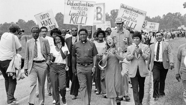 PHOTO: Rev. Joseph Lowery, head of the Southern Christian Leadership Conference, leads a protest march against a toxic waste dump opened in a predominantly Black and poor community in Afton, N.C., Oct. 21, 1982. (Bettmann Archive via Getty Images, FILE)