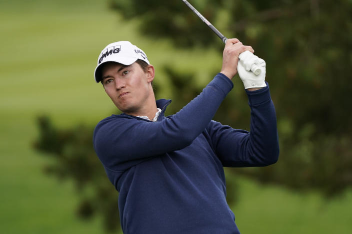 Maverick McNealy follows his drive from the second tee of the Pebble Beach Golf Links during the final round of the AT&T Pebble Beach Pro-Am golf tournament Sunday, Feb. 14, 2021, in Pebble Beach, Calif. (AP Photo/Eric Risberg)