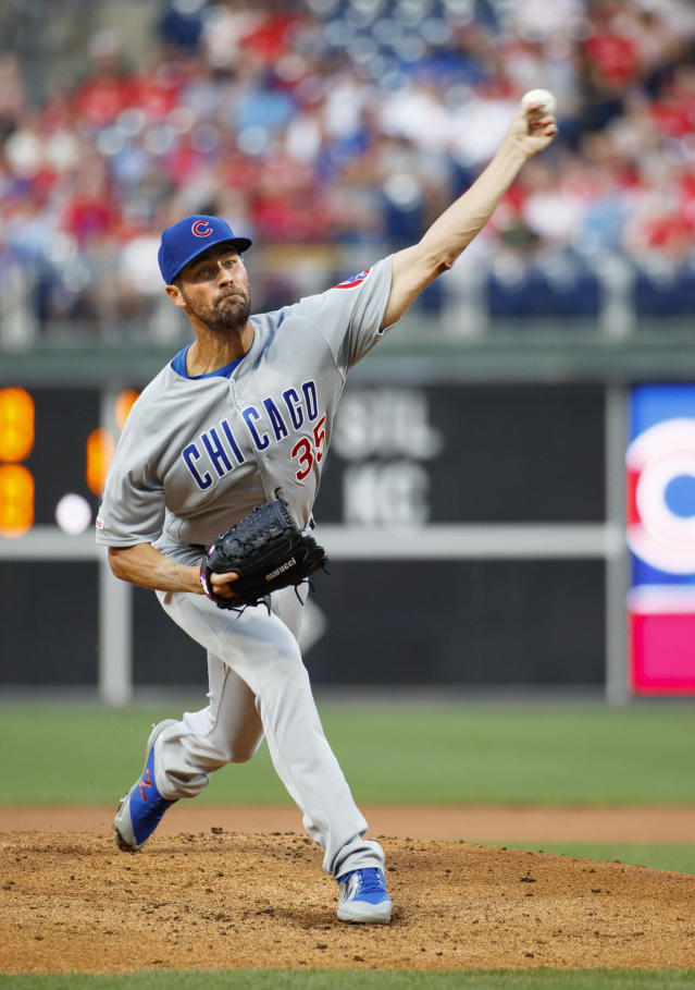Chicago Cubs starting pitcher Cole Hamels throws during the first inning of the team's baseball game against the Philadelphia Phillies, Wednesday, Aug. 14, 2019, in Philadelphia. (AP Photo/Chris Szagola)
