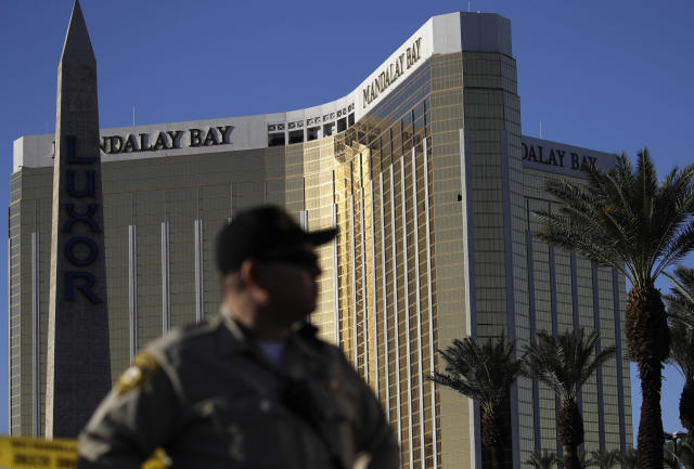 <p>A Las Vegas police officer stands by a blocked off area near the Mandalay Bay casino, Tuesday, Oct. 3, 2017, in Las Vegas. (Photo: John Locher/AP) </p>
