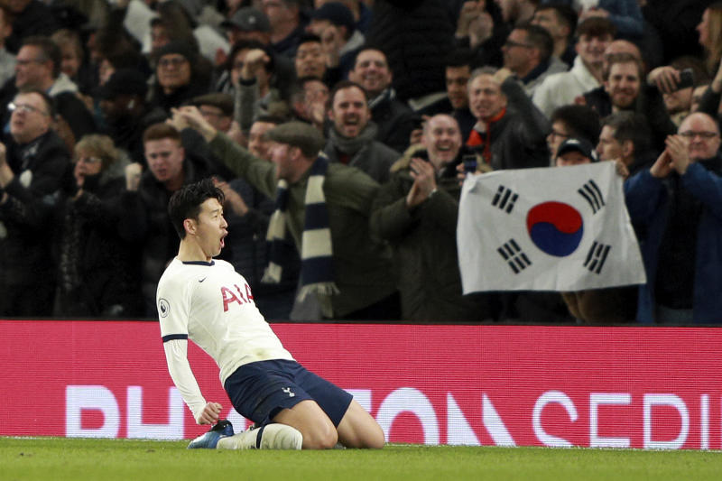 Tottenham's Son Heung-min celebrates after scoring his side's second goal during the English Premier League soccer match between Tottenham Hotspur and Manchester City at the Tottenham Hotspur Stadium in London, England, Sunday, Feb. 2, 2020. (AP Photo/Ian Walton)
