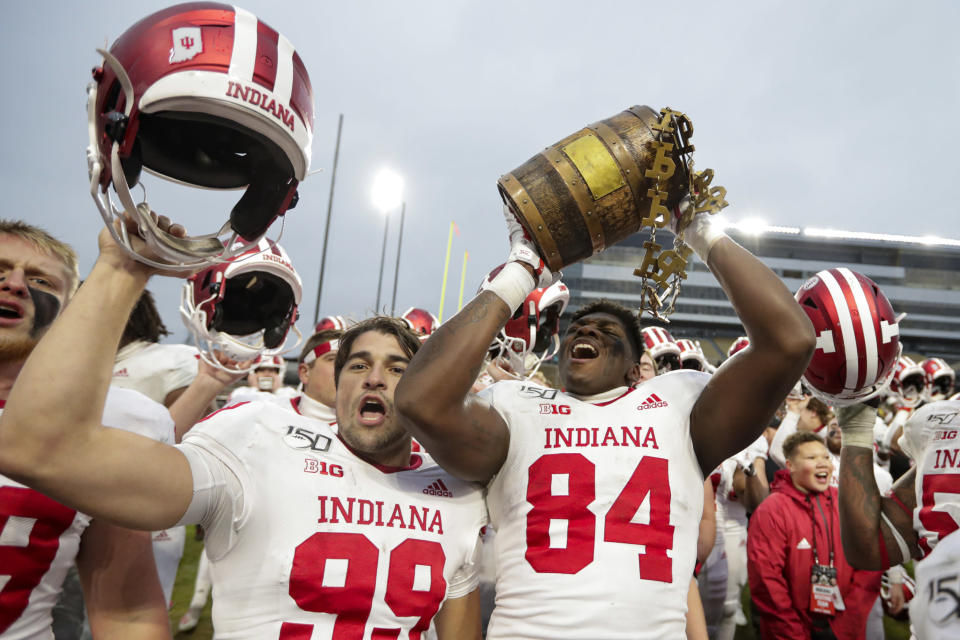 FILE - In this Nov. 30, 2019, file photo, Indiana tight end Turon Ivy Jr. (84) and place kicker Nathanael Snyder (99) celebrate with the Old Oaken Bucket following an NCAA college football game against Purdue in West Lafayette, Ind. Big Ten is going to give fall football a shot after all. Less than five weeks after pushing football and other fall sports to spring in the name of player safety during the pandemic, the conference changed course Wednesday, Sept. 16, 2020, and said it plans to begin its season the weekend of Oct. 23-24. (AP Photo/Michael Conroy, File)