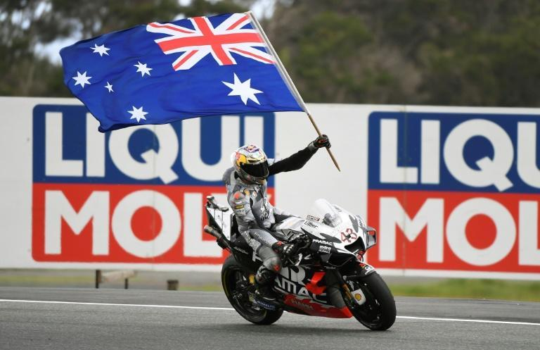 Jack Miller of Australia celebrates his third place in the MotoGP Australian motorcycle Grand Prix at Phillip Island. This year's race was cancelled on Wednesday