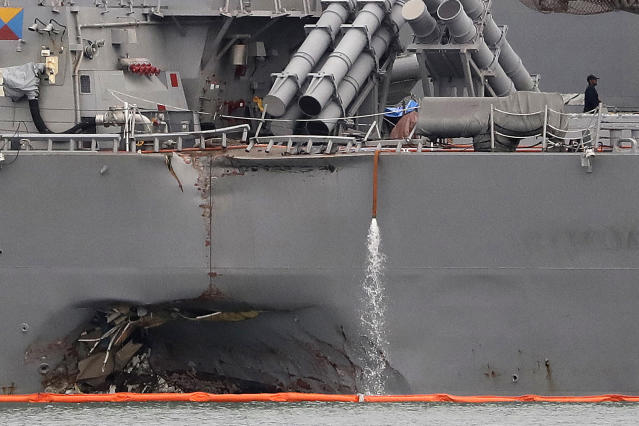 <p>The damaged port aft hull of the USS John S. McCain, is visible while docked at Singapore's Changi naval base on Aug. 22, 2017 in Singapore. (Photo: Wong Maye-E/AP) </p>