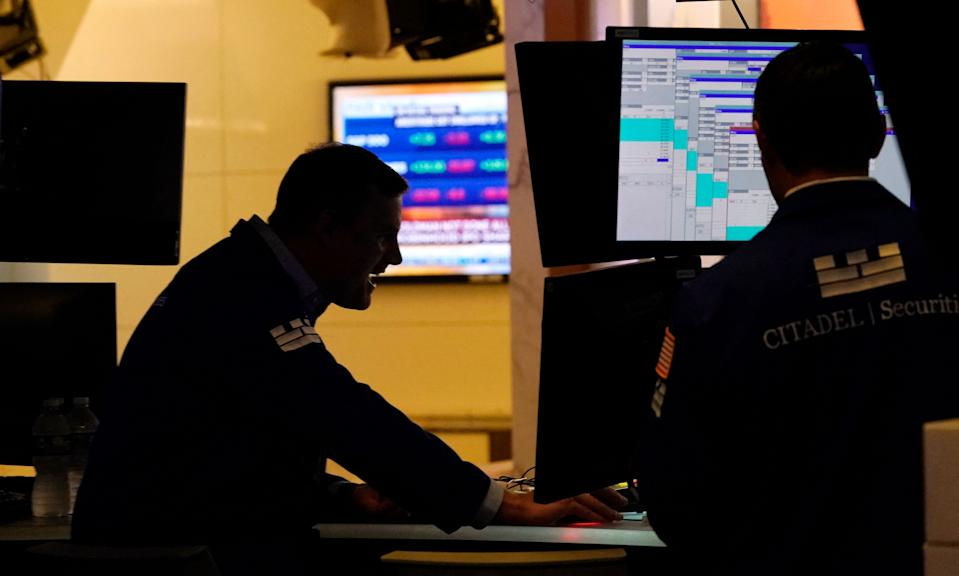 Traders work on the floor at the New York Stock Exchange in New York, on July 29, 2021. - Wall Street stocks climbed early July 29 following another round of mostly strong earnings and US data that showed strong second-quarter growth that lagged expectations. (Photo by TIMOTHY A. CLARY / AFP) (Photo by TIMOTHY A. CLARY/AFP via Getty Images)