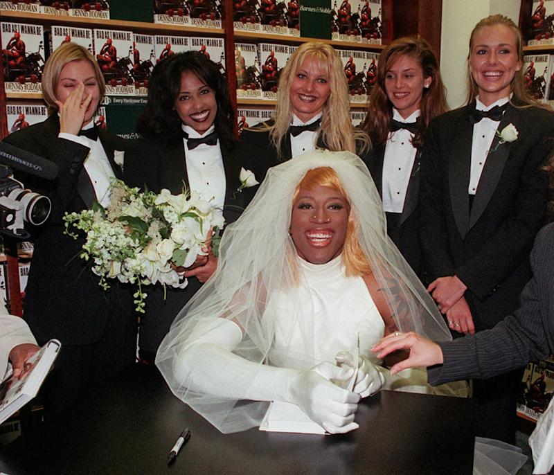 """FILE - This Aug. 21, 1996, file photo shows Chicago Bulls forward Dennis Rodman, dressed as a bride, poses for photographers at a New York bookstore while promoting his book, """"Bad As I Wanna Be."""" Beyond the outrageous outfits and tabloid tales,  Rodman was also a five-time NBA champion who won 70 percent of his games.  He gets recognition for his basketball achievements FridayAug. 12, 2011,  when he joins Dream Teamer Chris Mullin as the headline names in the 2011 Naismith Memorial Hall of Fame class. (AP Photo/Mark Lennihan)"""
