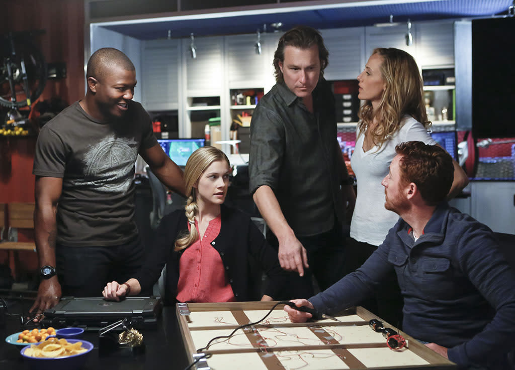"""Red: Part Two"" Pictured (L-R): Edwin Hodge (Tech Assistant Kai Ashe), Gillian Alexy (NCIS Special Agent Claire Keats), John Corbett (Roy Haines), Kim Raver (NCIS Special Agent Paris Summerskill) and Scott Grimes (NCIS Special Agent Dave Flynn). While the LA team chases leads digitally and locally, the NCIS: Red team travels in their mobile trucks, nicknamed ""Laverne and Shirley,"" in a race to track down a cunning terrorist before he disappears, on the conclusion of a two-part episode of NCIS: LOS ANGELES, Tuesday, March 26 (9:00-10:01 PM, ET/PT) on the CBS Television Network."