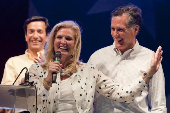 """Mitt Romney (R) reacts to his wife Ann's (2nd R) comment to supporters during Puerto Rico's pro-statehood New Progressive Party's (NPP) """"Get-out-the-vote"""" rally in front of the Capitol in Old San Juan March 16, 2012."""