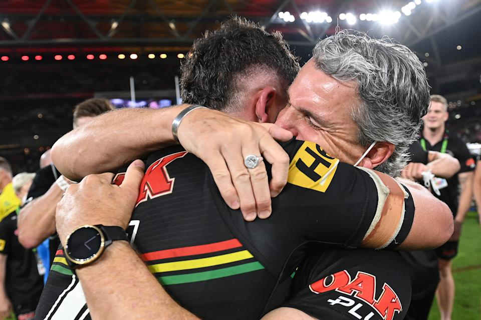 Pictured here, Penrith's Nathan Cleary hugs his father and coach Ivan after winning the 2021 NRL grand final.