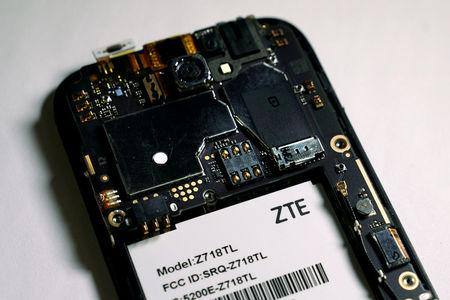 FILE PHOTO: The inside of a ZTE smart phone pictured in photo illustration