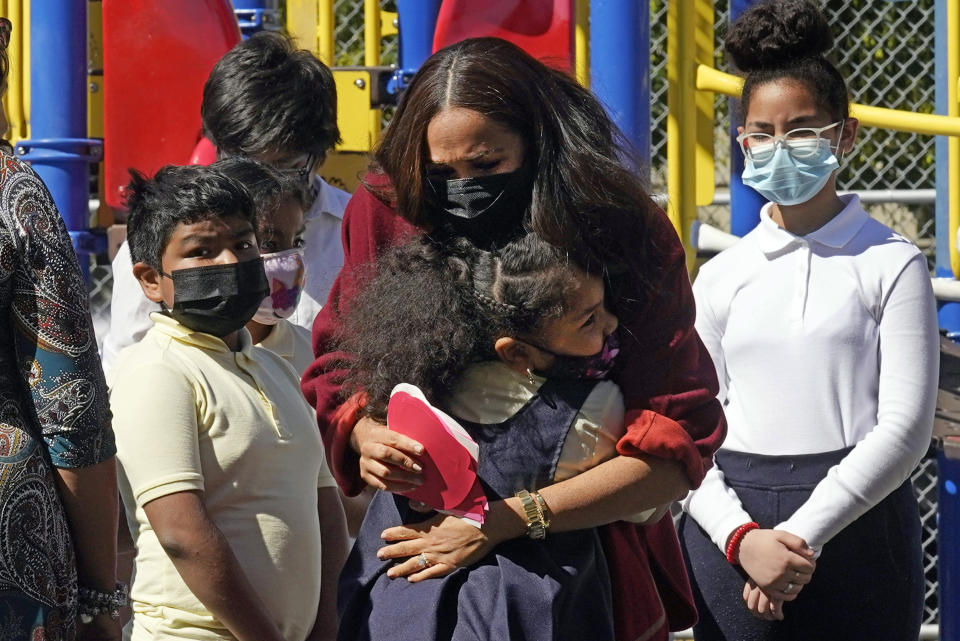 Meghan, the Duchess of Sussex, is hugged by a student during a visit to P.S. 123, the Mahalia Jackson School, in New York's Harlem neighborhood, Friday, Sept. 24, 2021. (AP Photo/Richard Drew)