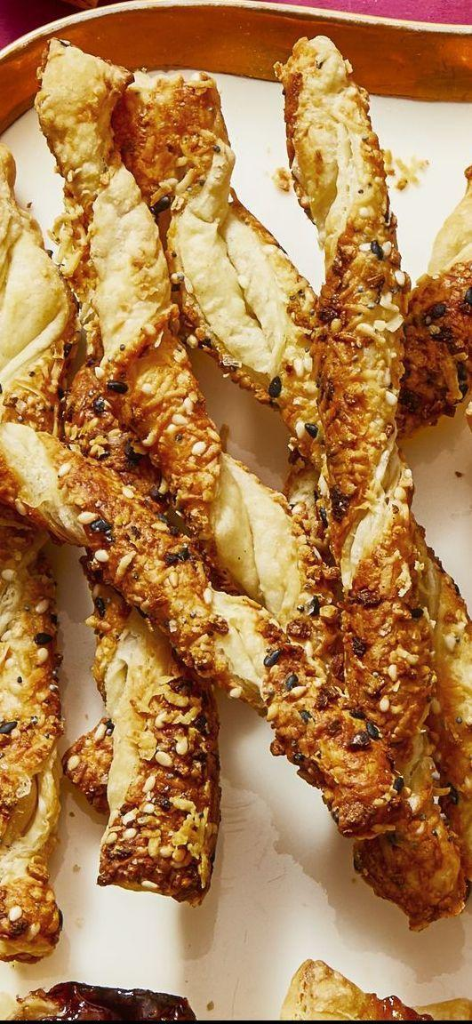 """<p>Add grated cheese and everything bagel seasoning into puff pastry — then watch your guests devour this irresistible snack in <em>seconds</em>. </p><p><em><a href=""""https://www.goodhousekeeping.com/food-recipes/a30381345/buffalo-glazed-chicken-two-ways-recipe/"""" rel=""""nofollow noopener"""" target=""""_blank"""" data-ylk=""""slk:Get the recipe for Pecorino-Everything Spice Straws »"""" class=""""link rapid-noclick-resp"""">Get the recipe for Pecorino-Everything Spice Straws »</a></em> </p>"""