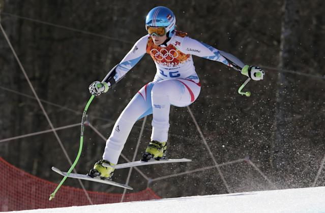 Austria's Nicole Hosp jumps in the women's super-G at the Sochi 2014 Winter Olympics, Saturday, Feb. 15, 2014, in Krasnaya Polyana, Russia. (AP Photo/Charles Krupa)