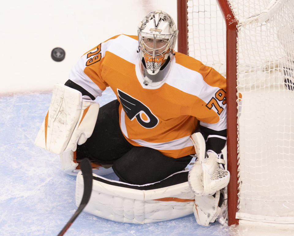 A stickless Philadelphia Flyers goaltender Carter Hart (79) watches the puck during the first period of NHL hockey Eastern Conference Stanley Cup first-round playoff action against the Montreal Canadiens in Toronto, Friday, Aug. 14, 2020. (Frank Gunn/The Canadian Press via AP)