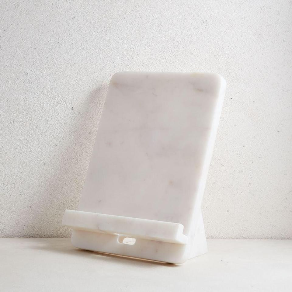 <p>You'll get a lot of use out of this <span>Marble Cookbook Stand</span> ($30).</p>