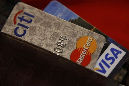 FILE PHOTO - Credit cards are pictured in a wallet in Washington, February 21, 2010.  REUTERS/Stelios Varias/File Photo
