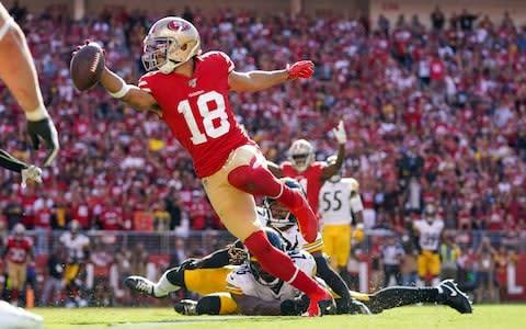 <span>Dante Pettis scores the touchdown which gave the 49ers the win</span> <span>Credit: USA Today </span>