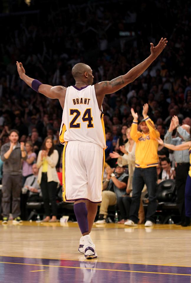 LOS ANGELES, CA - APRIL 22:  Kobe Bryant #24 of the Los Angeles Lakers celebrates with the fans during the second overtime against the Oklahoma City Thunder at Staples Center on April 22, 2012 in Los Angeles, California. The  Lakers won 114-106 in double overtime.  NOTE TO USER: User expressly acknowledges and agrees that, by downloading and or using this photograph, User is consenting to the terms and conditions of the Getty Images License Agreement.  (Photo by Stephen Dunn/Getty Images)