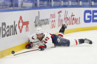 Washington Capitals forward Tom Wilson (43) falls during the first period of an NHL hockey game against the Buffalo Sabres, Friday, Jan. 15, 2021, in Buffalo, N.Y. (AP Photo/Jeffrey T. Barnes)