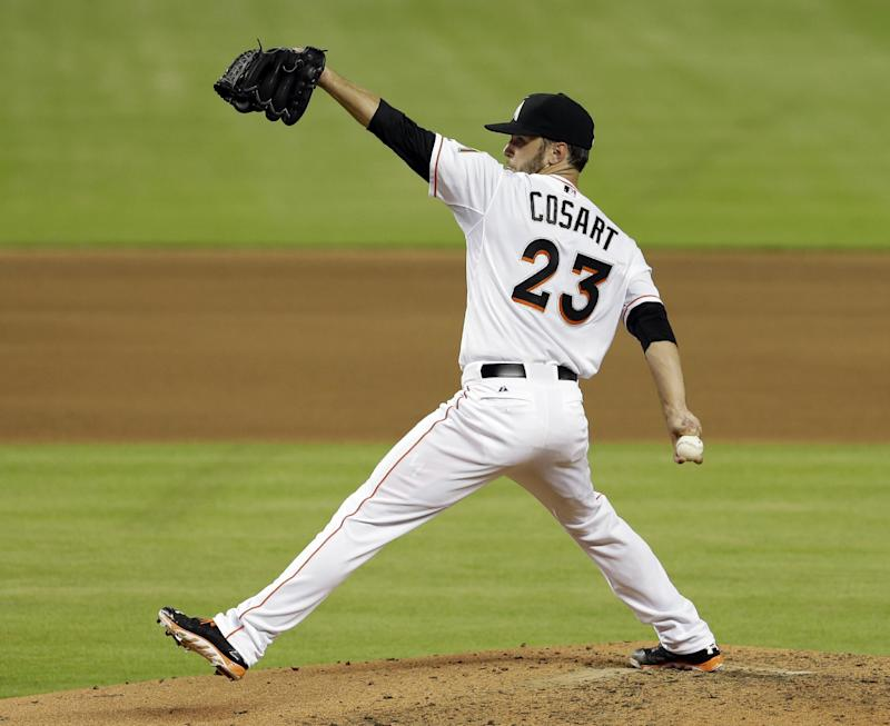 Marlins RHP Cosart scratched with strained side