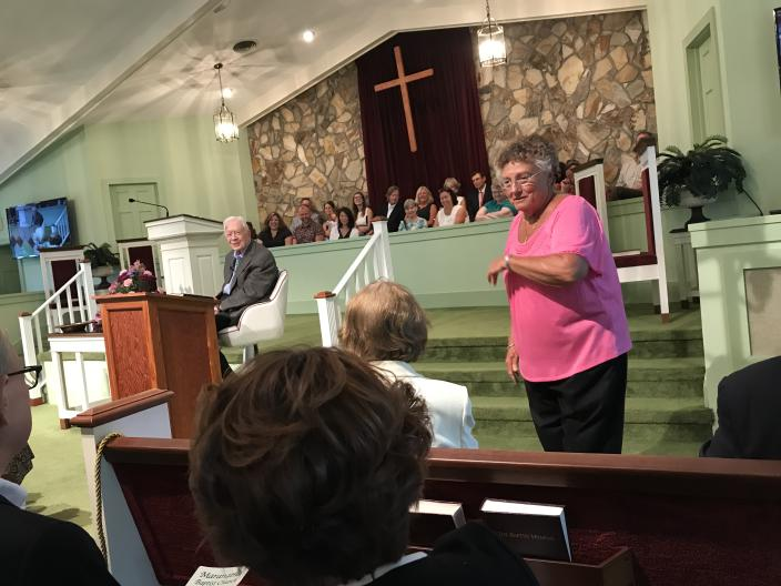 """Former President Jimmy Carter jokes with his wife, Rosalynn, about arriving a few moments into his Sunday school lesson at Maranatha Baptist Church. Carter was playfully reproved by Jan Williams, a member of the church since 1977: """"That's not nice,"""" Williams joked back at the ex-president. (Photo: Jon Ward/Yahoo News)"""