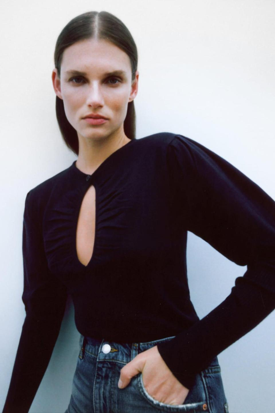 <p>This versatile <span>Zara Cutout Knit Sweater</span> ($40) is a great date night top.</p>