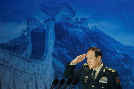Chinese Defence Minister Wei Fenghe salutes after addressing the Xiangshan Forum in Beijing