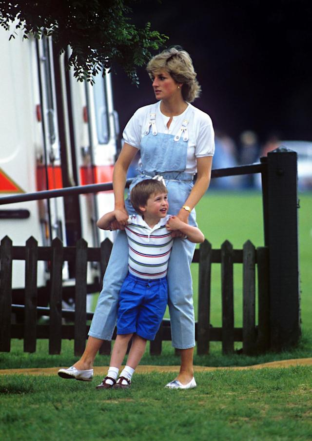 <p>Before Diana, royals were rarely seen wearing denim in public, let alone overalls. Her down-to-earth mom style endeared her to millions. (Photo: Julian Parker/UK Press via Getty Images) </p>