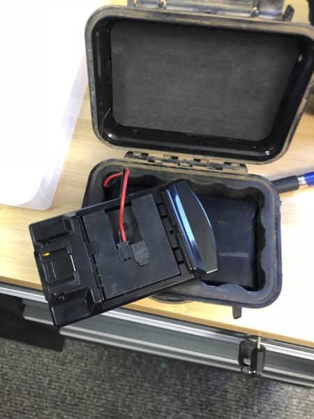 This December 2017 photo provided by Mark McBride shows what Oklahoma state Rep. Mark McBride, R-Moore, says is a tracking device that he removed from his truck in Oklahoma. McBride wants to know who put the contraption there and is one of at least five Oklahoma state lawmakers who in recent months asked a prosecutor to investigate claims they have been followed or threatened. (Mark McBride via AP)