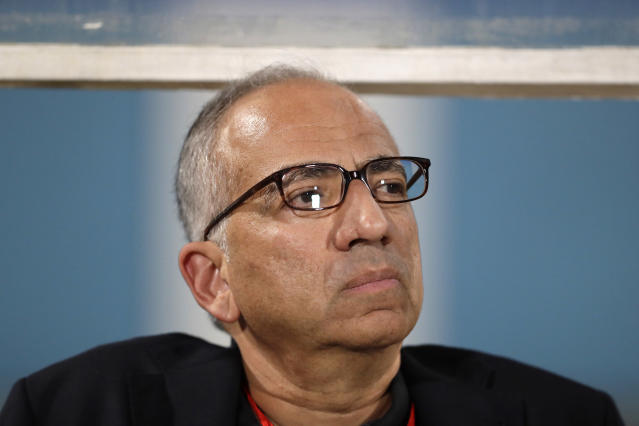 FILE - In this Oct. 10, 2017, file photo, Carlos Cordeiro, vice president of U.S. Soccer, watches warmups from the team bench ahead of the start of the U.S.'s final World Cup qualifying match against Trinidad and Tobago at Ato Boldon Stadium in Couva, Trinidad. Cordeiro has been elected president of the U.S. Soccer Federation on Saturday, Feb. 10, 2018, assuming control of an organization that must chart a new course after its men's team failed to qualify for this year's World Cup. (AP Photo/Rebecca Blackwell, File)