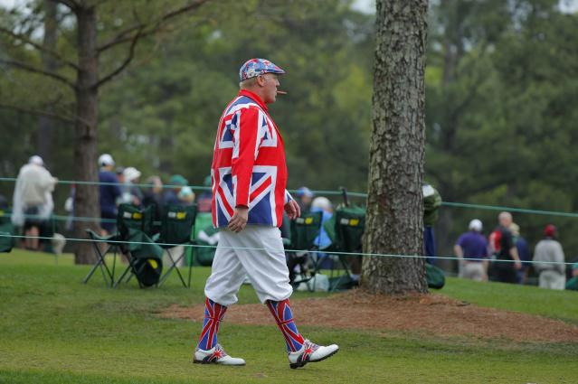 A gold patron smokes a cigar as he walks along the second fairway during third round play of the 2018 Masters golf tournament at the Augusta National Golf Club in Augusta, Georgia, U.S. April 7, 2018. REUTERS/Brian Snyder