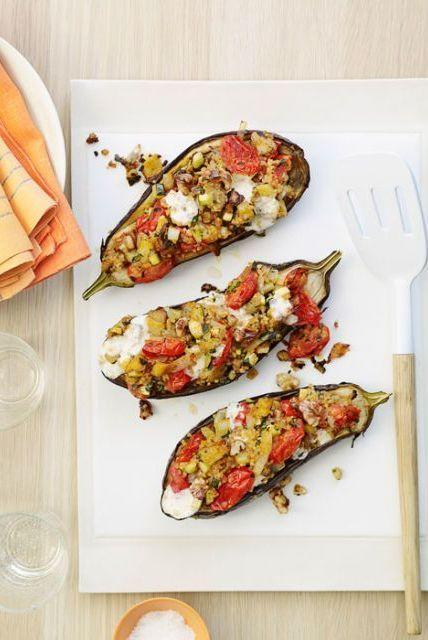 """<p>This vegetarian main dish easily becomes a complete meal when you add a simple side salad or some sautéed greens.</p><p>Get the <a href=""""https://www.delish.com/uk/cooking/recipes/a28960516/cheesy-stuffed-eggplants-recipe/"""" rel=""""nofollow noopener"""" target=""""_blank"""" data-ylk=""""slk:Cheesy Stuffed Aubergines"""" class=""""link rapid-noclick-resp"""">Cheesy Stuffed Aubergines</a> recipe.</p>"""