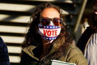 Heather Crim waits in line to cast her ballot during early voting at ONEOK Field in Tulsa