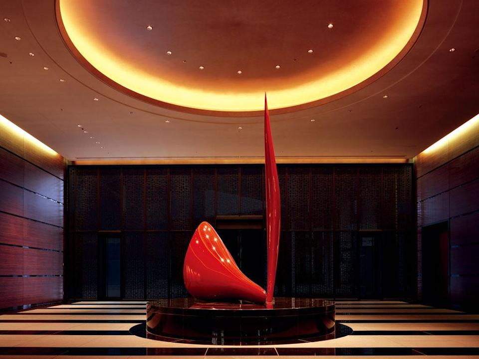 <p><strong>How did it strike you on arrival?</strong><br> When it opened in 2005 in the Shimbashi neighborhood, Conrad Tokyo was a seductively attractive hotel. More than a decade later, it remains as eye-catching as ever. Smack in the middle of the ground-floor, a glossy red sculpture marks the moodily lit entrance, and hasn't lost its dramatic effect. Up on the 28th-floor, a tall lobby soars with bold, black lines which are warmed with light boxes dangling from the ceiling. They say it's a business hotel, but it's dressed to impress.</p> <p><strong>The good stuff: Tell us about your room.</strong><br> The King Room Bay View hides nothing: Windows do, in fact, frame Tokyo Bay. But even better, the panoramic view also includes the lush Hamariku Gardens which flourish at the foot of the hotel. Modern furnishings borrow local motifs, whether they're the bedside lamps that vibe with Japanese lanterns or the Sumi-e cherry blossoms painted above the bed and woven across the floor's lightly patterned carpet.</p> <p><strong>How about the little things, like mini bar, or shower goodies. Any of that find its way into your suitcase?</strong><br> A perk of the Conrad's branding: You aren't stuck with one label of toiletries like most hotels because you can pick from a selection of four makers (from Aromatherapy Associates to Shanghai Tang).</p> <p><strong>Please tell us the bathroom won't let us down.</strong><br> Glass walls separate the bathroom and the bedroom but are easily sealed off with wooden blinds. Stark, black surfaces are brightened with white tiled walls and fixtures, the most brilliant of which is an oversized circular mirror that's outlined in a thick embedded light.</p> <p><strong>Maybe the most important topic of all: Wi-Fi. What's the word?</strong><br> Wi-Fi? Not free.</p> <p><strong>Room service: Worth it?</strong><br> Yes, there's room service, but knock-knock—hello!—a handful of Michelin-starred restaurants are just an elevator ride away.</p> <p><strong>A