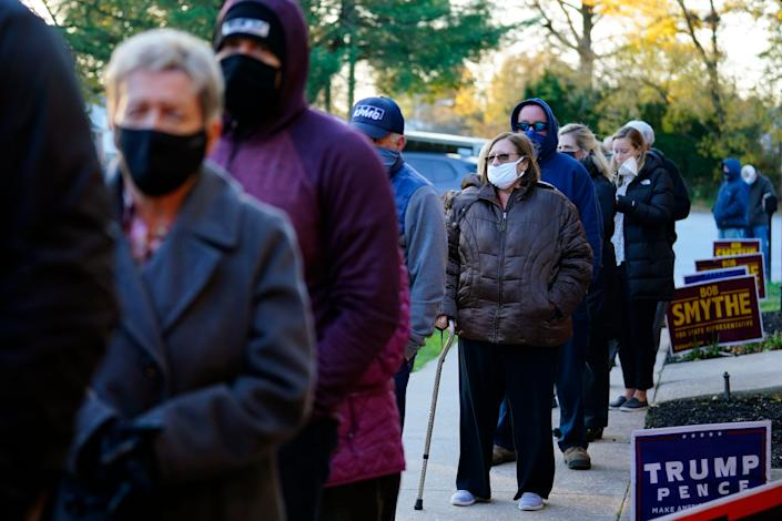 People line up outside a polling place to vote in the 2020 general election in the United States, Tuesday, Nov. 3, 2020, in Springfield, Pennsylvania.