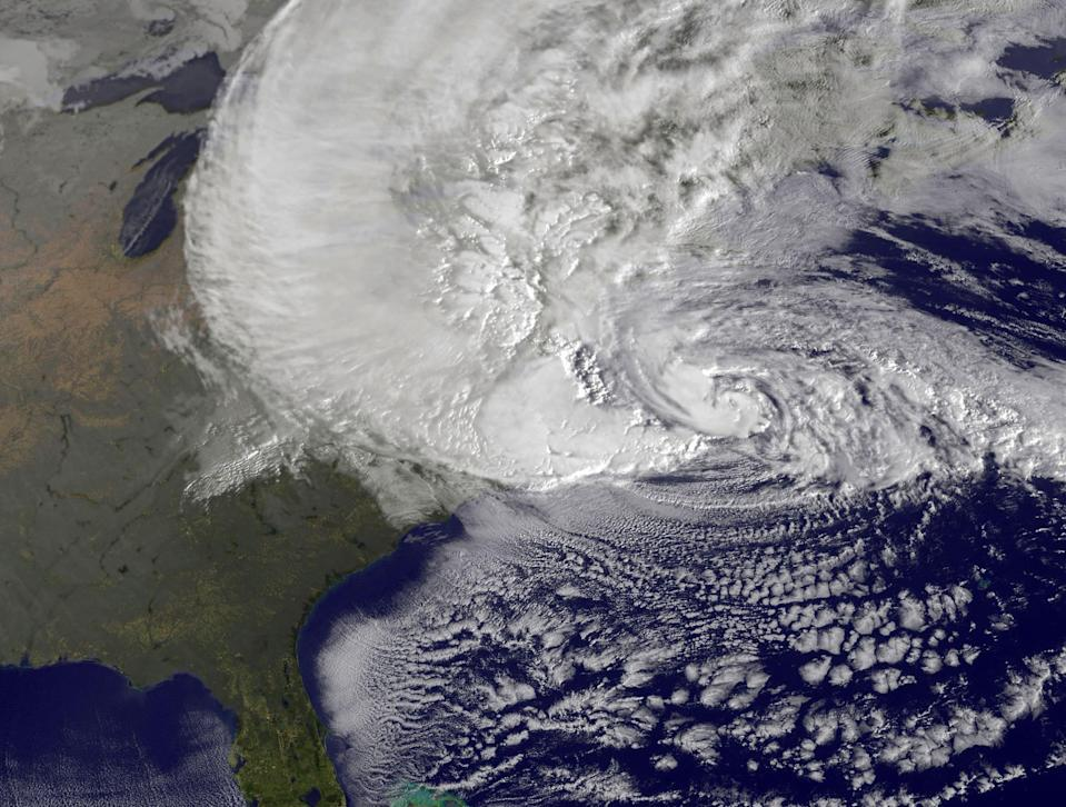 AT SEA - OCTOBER 29: In this handout GOES satellite image provided by NASA, Hurricane Sandy, pictured at 1240 UTC, churns off the east coast on October 29, 2012 in the Atlantic Ocean. Sandy, which has already claimed over 50 lives in the Caribbean is predicted to bring heavy winds and floodwaters to the mid-Atlantic region. (Photo by NASA via Getty Images)
